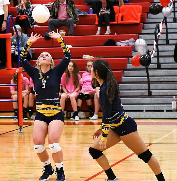 Rifle Bear Nikala Fitzsimmons sets the ball for Maddy Valencia during Tuesday night's game against the Glenwood Springs Demons.