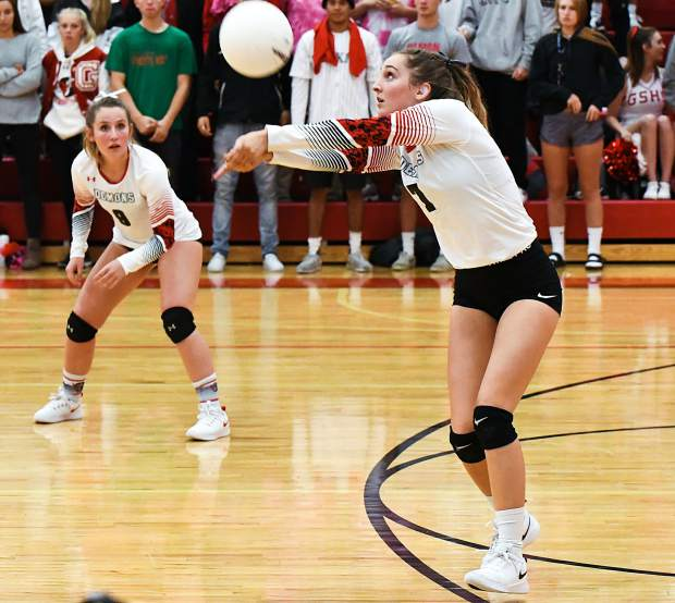 Glenwood Springs Demon Sarah Wagner sets the ball during Tuesday night's game against the Rifle Bears at Glenwood Springs HIgh School.