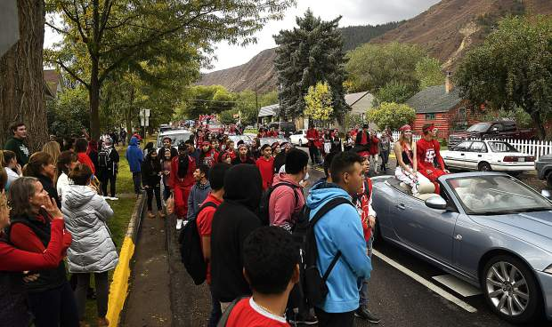 Glenwood Springs High School students make their way down Pitkin Avenue in front of a crowd of Demon supporters as they head for Glenwood Springs Elementary during Friday's Homecoming parade.