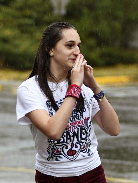 A Glenwood Springs High School band member gets caught in Friday afternoons sudden downpour that brought the homecoming parade to a quick end and thunder and lightning moved through the valley.