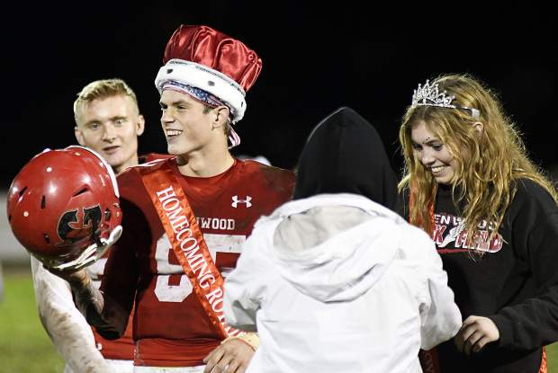 Wyatt Ewer and Sequoia Kellogg are all smles after being named homcoming king and queen during halftime Friday.