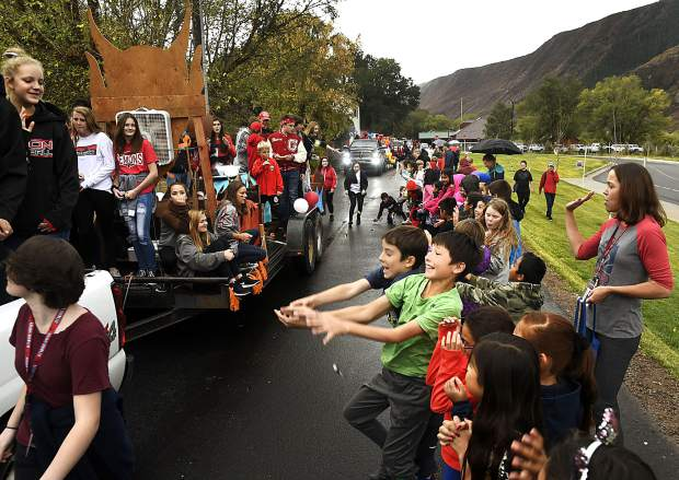 Glenwood Springs Elementary students battle for candy and to show their Demon pride as they line School Street for annual Homecoming parade Friday afternoon.