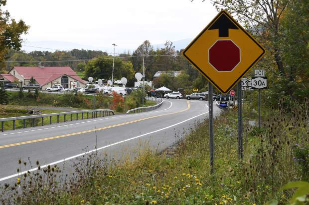 Television networks broadcast at the roadside memorial scene of Saturday's fatal limousine crash in Schoharie, N.Y., Monday, Oct. 8, 2018. A limousine loaded with people headed to a birthday party blew the stop sign at the end of a highway and slammed into an SUV parked outside a store, killing all people in the limo and a few pedestrians, officials and relatives of the victims said. (AP Photo/Hans Pennink)