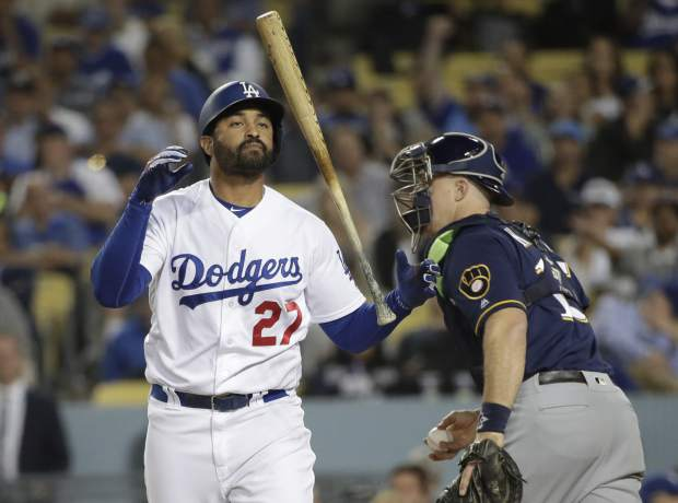 Los Angeles Dodgers' Matt Kemp reacts after striking out during the eighth inning of Game 3 of the National League Championship Series baseball game against the Milwaukee Brewers Monday, Oct. 15, 2018, in Los Angeles. (AP Photo/Jae Hong)