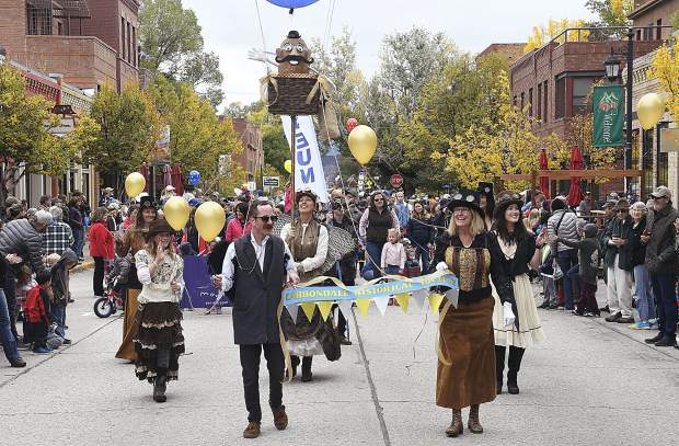 Members of the Carbondale Historical Society show off their steampunk theme as they walk through the crowd on Main Street during the 109th Potato Day festivities Saturday.