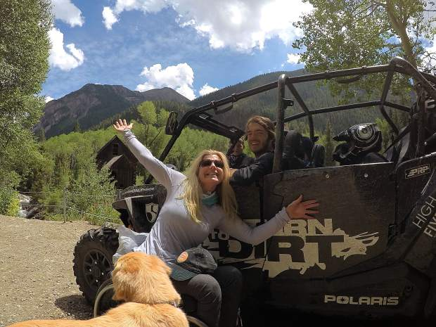Amanda Boxtel, front, and Tim Burr, in the driver's seat, out on the trail during a Return to Dirt backcountry adventure.