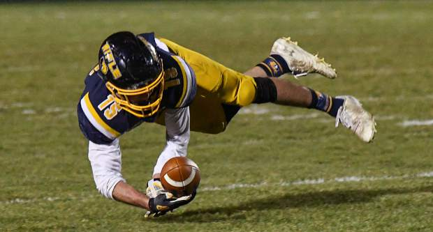 Rifle Bear Dalton Pruett leaps for the ball during Friday night's game against the Basalt Longhorns.