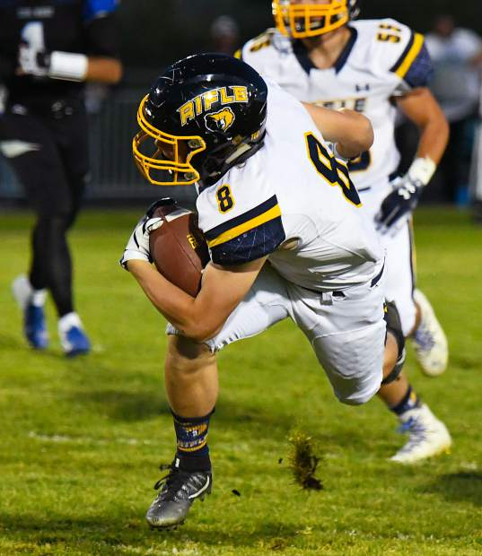 Rifle Bear Levi Warfel is tripped up while running the ball down the field during Friday night's game against the Coal Ridge Titans.