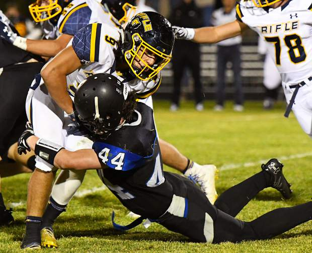Coal Ridge's Josh Taylor tackles Rifle Bear Tanner Vines during Friday night's game at Coal Ridge HIgh School.
