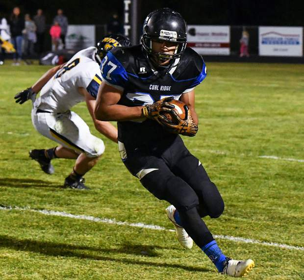Coal Ridge Titan Moises Contreras picks off a Rifle pass during Friday night's game against the Rifle Bears.