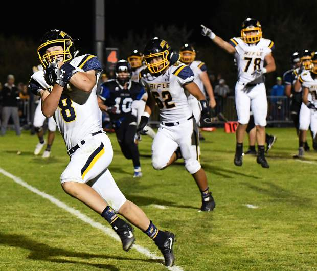 Rifle Bear Levi Warfel runs the ball into the end zone early in the second half during Friday night's game against the Coal Ridge Titans.