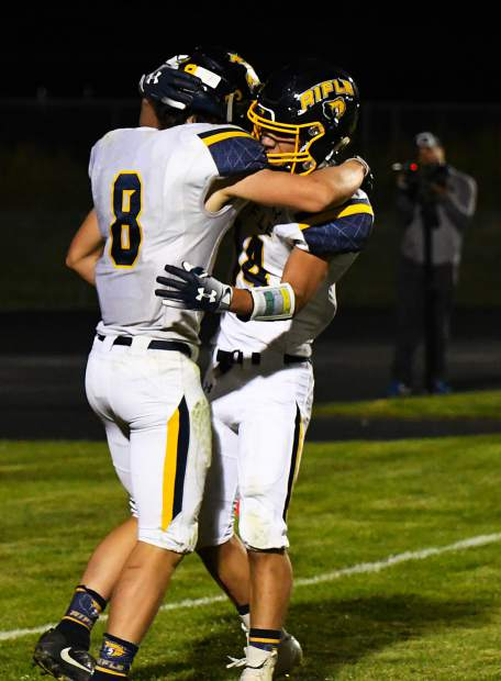 Rifle Bears Levi Warfel and Talon Cordova celebrate after a touchdown early in the second half against the Coal Ridge Titans.