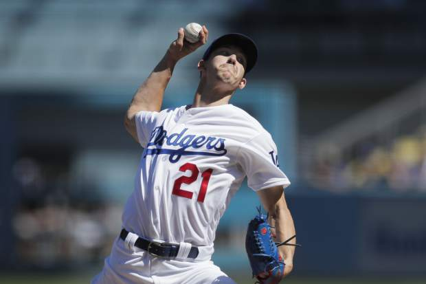 Los Angeles Dodgers starting pitcher Walker Buehler throws against the Colorado Rockies during the first inning of a tiebreaker baseball game, Monday, Oct. 1, 2018, in Los Angeles. (AP Photo/Jae C. Hong)