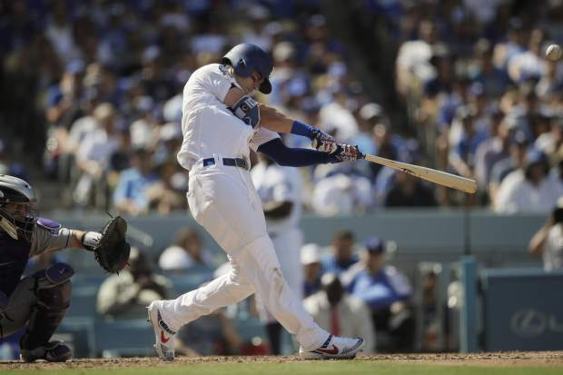 Los Angeles Dodgers' Cody Bellinger hits a two-run home run during the fourth inning of a tiebreaker baseball game against the Colorado Rockies, Monday, Oct. 1, 2018, in Los Angeles. (AP Photo/Jae C. Hong)