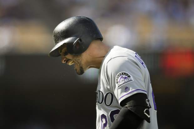 Colorado Rockies' Nolan Arenado reacts after he flied out during the fourth inning of a tiebreaker baseball game against the Los Angeles Dodgers, Monday, Oct. 1, 2018, in Los Angeles. (AP Photo/Jae C. Hong)