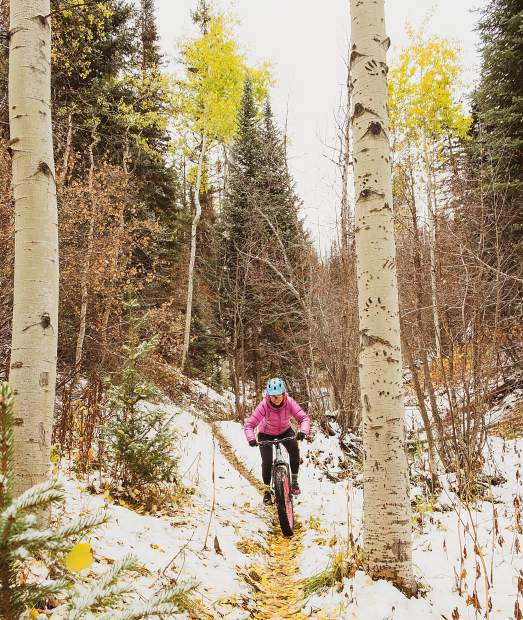 Ann Driggers fat bikes Oct. 13 on the Ditch Trail on Basalt Mountain.