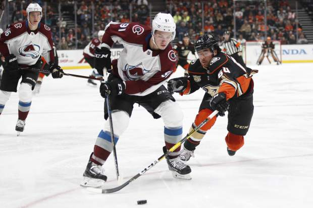 Colorado Avalanche's Vladislav Kamenev, left, of Russia, is defended by Anaheim Ducks' Kiefer Sherwood during the second period of an NHL hockey game Sunday, Nov. 18, 2018, in Anaheim, Calif. (AP Photo/Jae C. Hong)