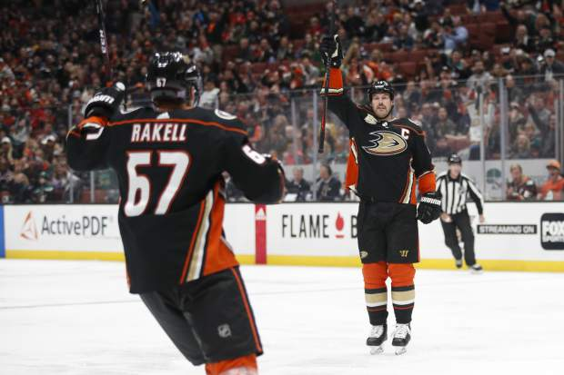 Anaheim Ducks' Ryan Getzlaf, right, and Rickard Rakell, of Sweden, celebrate a goal by Getzlaf during the second period of an NHL hockey game against the Colorado Avalanche Sunday, Nov. 18, 2018, in Anaheim, Calif. (AP Photo/Jae C. Hong)