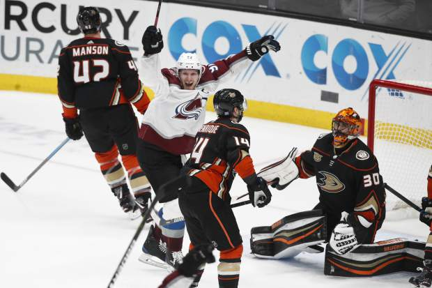 Colorado Avalanche's Gabriel Landeskog, second from left, of Sweden, celebrates a goal by Mikko Rantanen in overtime of an NHL hockey game against the Anaheim Ducks on Sunday, Nov. 18, 2018, in Anaheim, Calif. The Avalanche won 4-3. (AP Photo/Jae C. Hong)