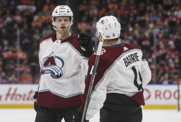Colorado Avalanche's Carl Soderberg (34) and Tyson Barrie (4) celebrate a goal against the Edmonton Oilers during first period NHL hockey action in Edmonton, Alberta on Sunday Nov. 11, 2018. (Jason Franson/The Canadian Press via AP)