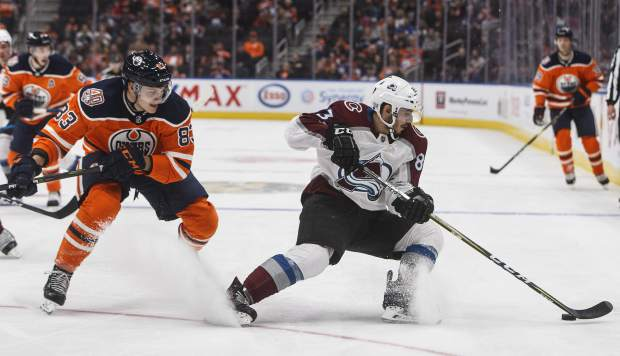 Colorado Avalanche' Matt Nieto (83) is chased by Edmonton Oilers' Matthew Benning (83) during the third period of an NHL hockey game in Edmonton, Alberta, Sunday, Nov. 11, 2018. Colorado won, 4-1. (Jason Franson/The Canadian Press via AP)