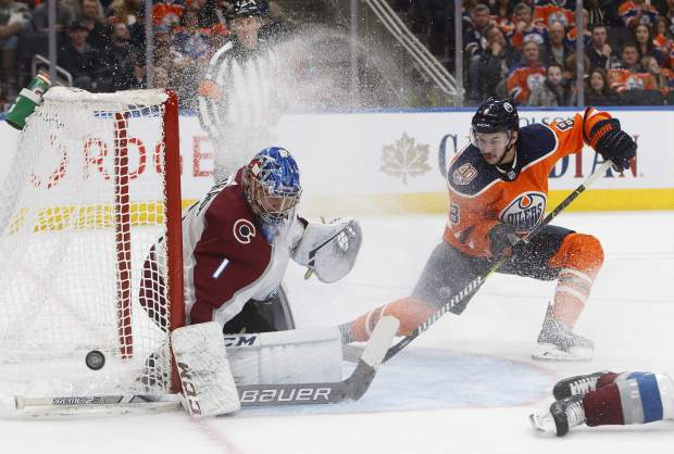 Colorado Avalanche goalie Semyon Varlamov (1) makes the save on Edmonton Oilers' Ty Rattie (8) during second period NHL hockey action in Edmonton, Alberta on Sunday Nov. 11, 2018. (Jason Franson/The Canadian Press via AP)