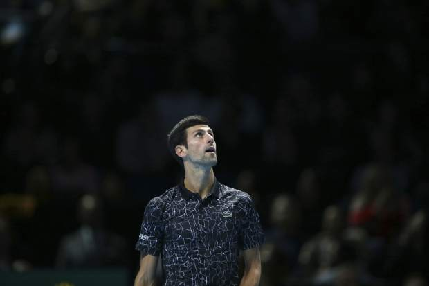 Novak Djokovic of Serbia watches a challenge against Alexander Zverev of Germany in their ATP World Tour Finals singles final tennis match at the O2 Arena in London, Sunday Nov. 18, 2018. (AP Photo/Tim Ireland)