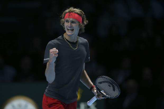 Alexander Zverev of Germany celebrates breaking serve against Novak Djokovic of Serbia in their ATP World Tour Finals singles final tennis match at the O2 Arena in London, Sunday Nov. 18, 2018. (AP Photo/Tim Ireland)