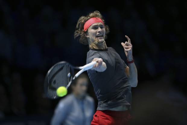 Alexander Zverev of Germany returns to Novak Djokovic of Serbia in their ATP World Tour Finals singles final tennis match at the O2 Arena in London, Sunday Nov. 18, 2018. (AP Photo/Tim Ireland)