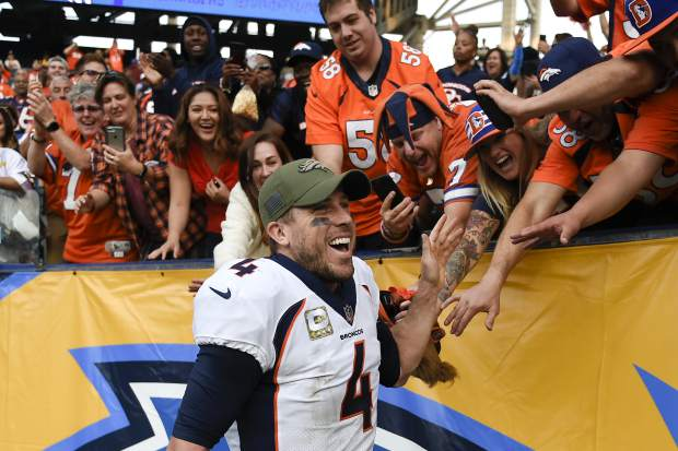 Denver Broncos quarterback Case Keenum celebrates after win against the Los Angeles Chargers an NFL football game Sunday, Nov. 18, 2018, in Carson, Calif. (AP Photo/Kelvin Kuo)