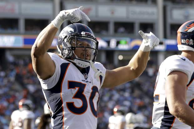 Denver Broncos running back Phillip Lindsay celebrates after scoring during the first half of an NFL football game against the Los Angeles Chargers Sunday, Nov. 18, 2018, in Carson, Calif. (AP Photo/Marcio Jose Sanchez)
