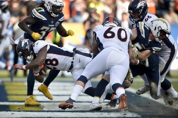 Denver Broncos running back Royce Freeman scores against the Los Angeles Chargers during the second half of an NFL football game Sunday, Nov. 18, 2018, in Carson, Calif. (AP Photo/Kelvin Kuo)