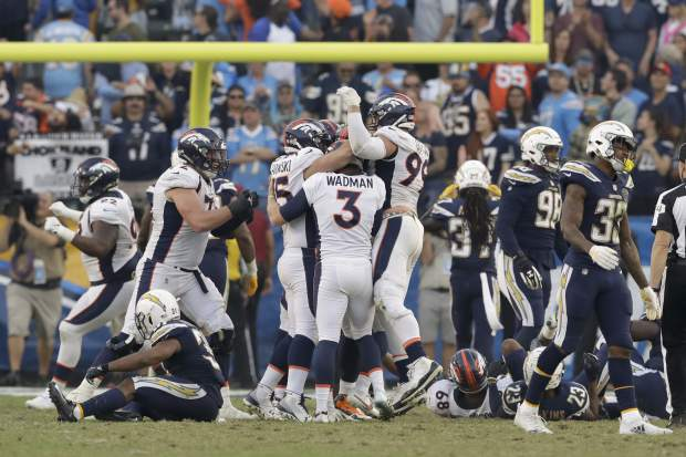 Members of the Denver Broncos celebrates after their winning field goal against the Los Angeles Chargers during the second half of an NFL football game Sunday, Nov. 18, 2018, in Carson, Calif. (AP Photo/Marcio Jose Sanchez)