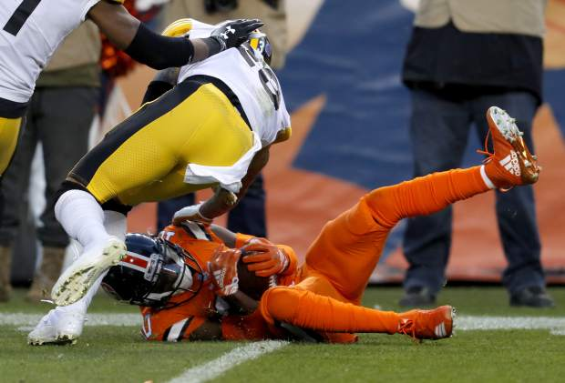 Denver Broncos wide receiver Emmanuel Sanders (10) pulls in a first down and goal catch as Pittsburgh Steelers cornerback Joe Haden defends during the first half of an NFL football game, Sunday, Nov. 25, 2018, in Denver. (AP Photo/David Zalubowski)