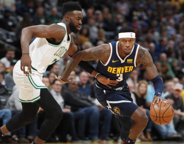 Denver Nuggets forward Torrey Craig, right, drives to the basket past Boston Celtics guard Jaylen Brown in the first half of an NBA basketball game Monday, Nov. 5, 2018, in Denver. (AP Photo/David Zalubowski)