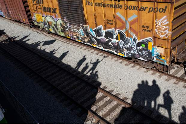 The shadows of migrants are cast on the railroad tracks at the Mexico-U.S. border in Tijuana, Mexico, Sunday, Nov. 25, 2018, as a group of migrants tries to reach the U.S. The mayor of Tijuana has declared a humanitarian crisis in his border city and says that he has asked the United Nations for aid to deal with the approximately 5,000 Central American migrants who have arrived in the city. (AP Photo/Rodrigo Abd)
