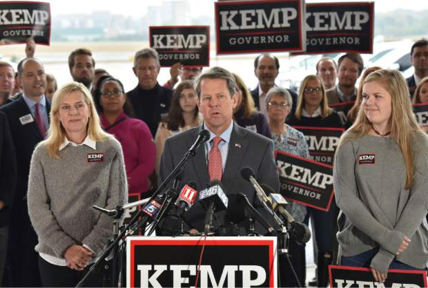 Georgia Republican gubernatorial candidate Brian Kemp speaks during a campaign stop at Peachtree DeKalb Airport on Monday.