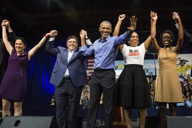 Former President Barack Obama, center, headlines a rally and appears alongside, from left to right, Illinois Comptroller Susana Mendoza, gubernatorial candidate J.B. Pritzker, lieutenant governor candidate Juliana Stratton and congressional candidate Lauren Underwood, Sunday, Nov. 4, 2018, at the University of Illinois at Chicago, in Chicago. (Ashlee Rezin/Chicago Sun-Times via AP)