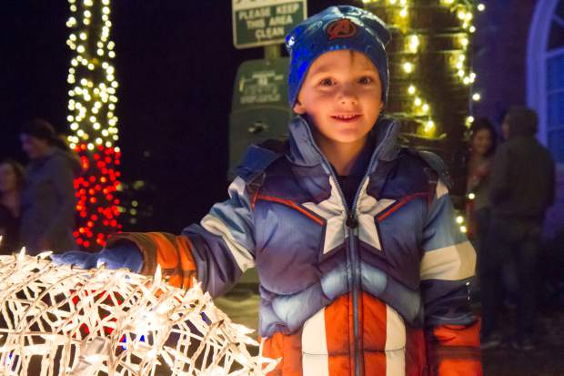 Five-year-old Colin Wise checks out the lights outside the Hotel Colorado during the 28th annual Festival of Lights on Friday evening last year.