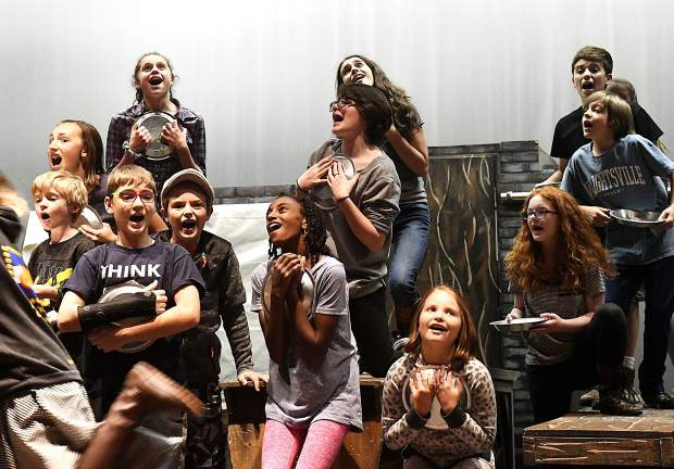 """Cast members walk through a scene during Monday's first full rehearsal of Defiance Community Players' production of """"Oliver"""" on the stage in Jeannie Miller Theatre at Glenwood Springs High School on Monday. After a two-year absence Defiance is set to open its latest production at 7 p.m. Nov. 9."""