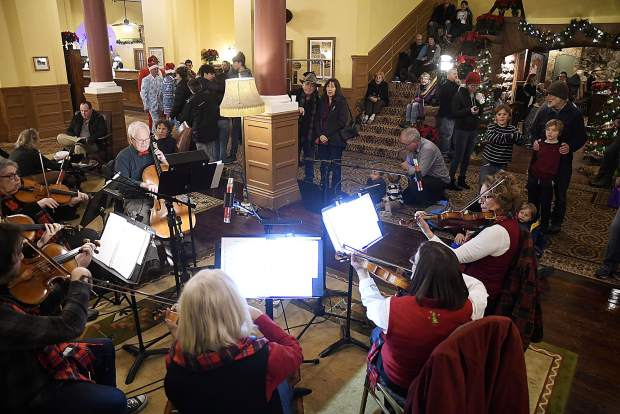 Symphony of the Valley performs in the lobby of the Hotel Colorado Friday during preliminary events of the annual Festival of Lights.