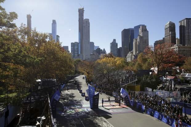 Lelisa Desisa of Ethiopia crosses the finish line first in the men's division of the New York City Marathon in New York, Sunday, Nov. 4, 2018. (AP Photo/Seth Wenig)
