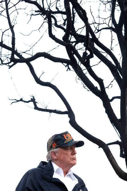 President Donald Trump spends a moment with his thoughts while touring damage from the Woolsey Fire in Malibu, Calif., on Saturday, Nov. 17, 2018. Trump arrived at the oceanside conclave Saturday afternoon after visiting Northern California to survey the wildfire damage in the town of Paradise. (Genaro Molina/Los Angeles Times via AP, Pool)