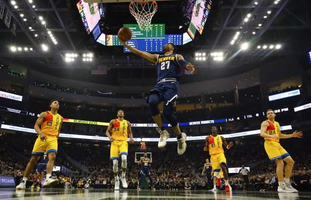 Denver Nuggets' Jamal Murray shoots during the first half of an NBA basketball game against the Milwaukee Bucks Monday, Nov. 19, 2018, in Milwaukee. (AP Photo/Morry Gash)
