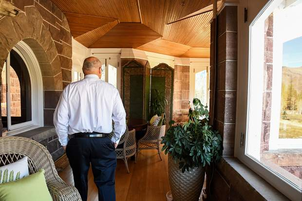 Redstone Castle owner Steve Carver walks through the sunroom of the recently restored castle during a media tour on Thursday morning.
