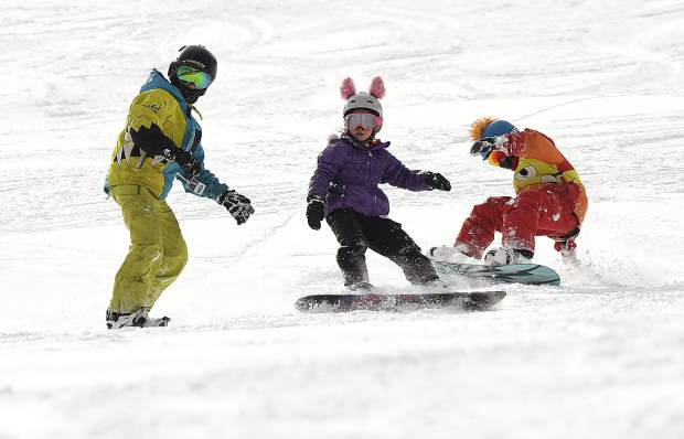 Sunlight Mountain Resort thrives with activity as a trio of riders take to the slopes.