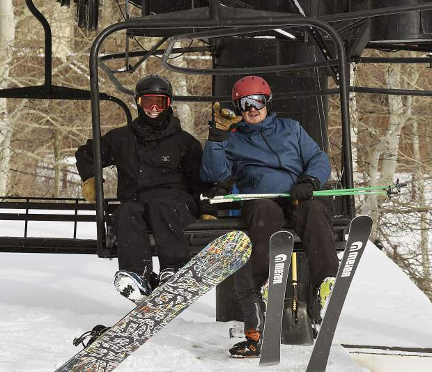 A pair of winter sports enthusiasts settle in for their ride up the Tercero lift Friday at Sunlight Mountain Resort.