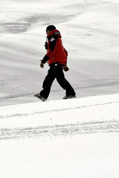 A ski patrol member walks the slopes of Sunlight Mountain Resort Friday as the resort celebrates its 52nd season.