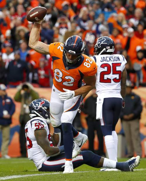 Denver Broncos tight end Jeff Heuerman (82) celebrates his touchdown catch as Houston Texans strong safety Kareem Jackson (25) and inside linebacker Benardrick McKinney (55) look away during the second half of an NFL football game, Sunday, Nov. 4, 2018, in Denver. (AP Photo/Jack Dempsey)