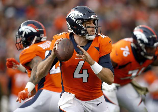 Denver Broncos quarterback Case Keenum (4) looks to throw against the Houston Texans during the first half of an NFL football game, Sunday, Nov. 4, 2018, in Denver. (AP Photo/David Zalubowski)